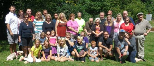 My cousin Chrissy & I have been planning these for the last 3 years. It has been nice to get our family back together. I'm the last one on the right of the front row. Don't let that hug fool you, I was torturing my little cousin, James. He loves it and he knows it!